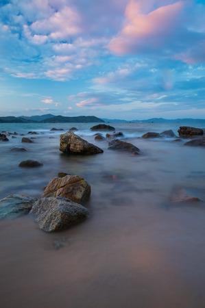 colourful sky: Rocky coastline on the south China sea off the coast of Vietnam with a colourful sky.