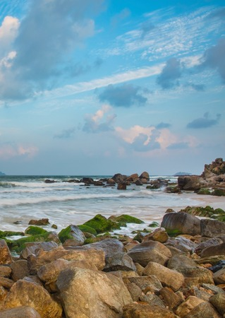 A rocky ocean coastline over the south China sea in the bay of Vung Lam Bay Vietnam.