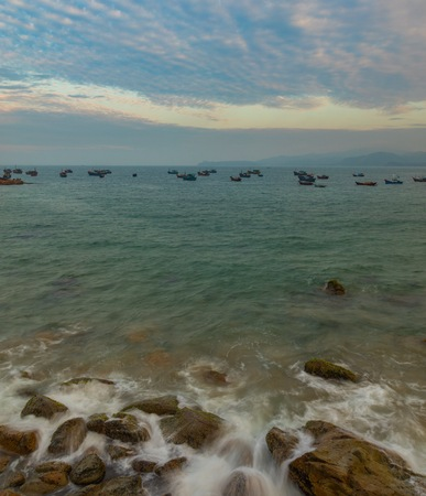 aisa: A rocky coastline looking out over the south China sea in Vung Lam Bay Vietnam.
