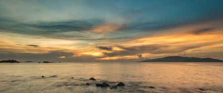 colourful sky: A view of Nha Trang bay just after sunrise with a colourful cloudy sky. Stock Photo
