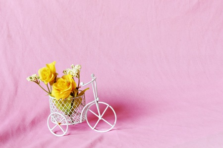 decorated bike: yellow flower on a bicycle  with pink background