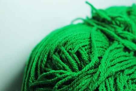 ball of wool: green wool yarn ball  Closeup Stock Photo