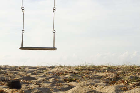 lonely swing at sea beach bright morning sky Stock Photo - 13784883