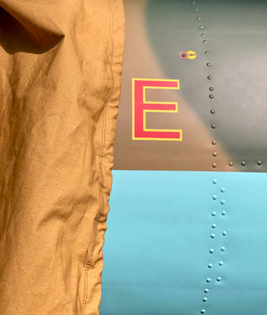 letter E, riveted seam, tarp, aircraft, luck, luck, satisfaction
