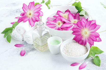 clematis: Massage and Spa products with flowers clematis Stock Photo