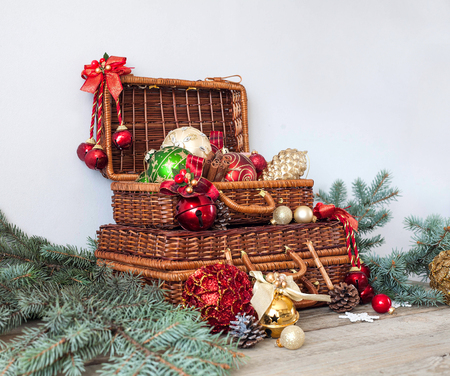 christmas composition christmas decorations in wicker baskets with fir tree branches on wooden background stock - Christmas Basket Decorations