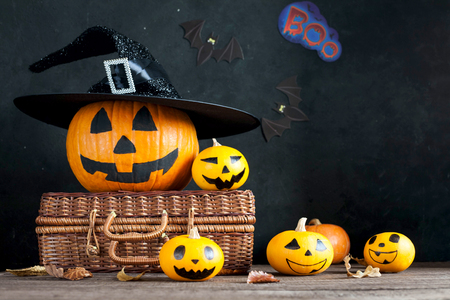Pumpkin for Halloween with painted faces. Background for Halloween. Stock Photo
