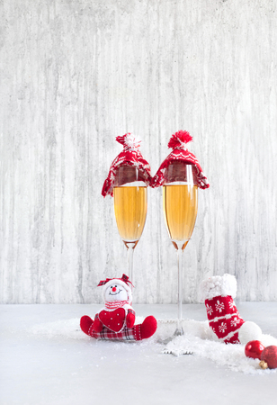 Glasses of champagne at new years eve on a light background in the snow.