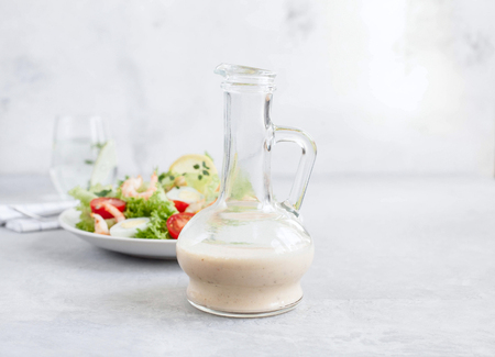 Salad dressing are homemade from olive oil, eggs, garlic, and spices.