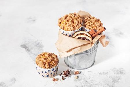 Pumpkin muffins with strasheim on a light background