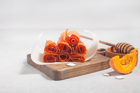 Dried pumpkin flesh on a light background Stock Photo