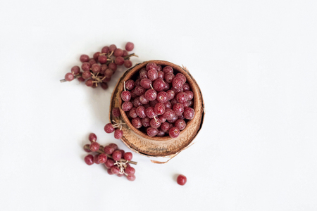 Shepherdia berries on a white background