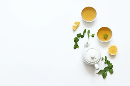Herbal tea from mint and other herbs on a white background. T Foto de archivo