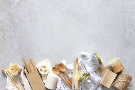 Items made of natural materials. The concept of zero waste. Natural bamboo toothbrush, drinking tube, natural sponge, on a gray background. Flat layout, top view, space for copying. 版權商用圖片