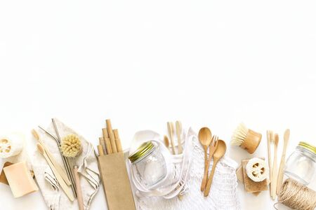Items made of natural materials. The concept of zero waste. Natural bamboo toothbrush, drinking tube, natural sponge, on a white background . Flat layout, top view, space for copying.