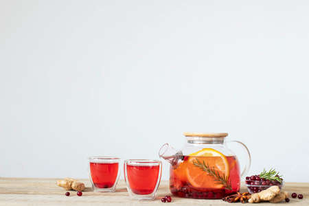 Fruit and berry tea with cranberries orange rosemary and cinnamon. Healthy drinks.