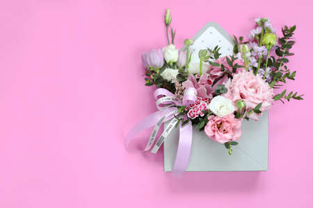 Bouquet as a gift for the holiday of March 8, St. Valentine's Day, mother's day, birthday, wedding day. Floral arrangement of tulips, eustoma, ranunculus, orchids, chrysanthemums, eucalyptus branches. Standard-Bild