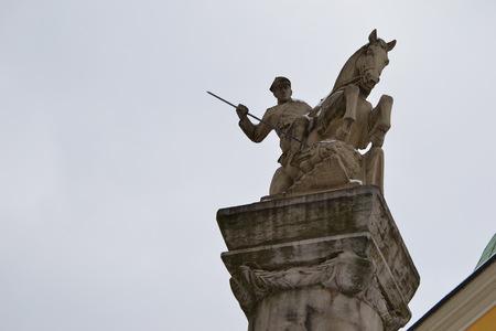 slaying: Horseman slaying a dragon. Poznan. Poland