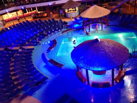glow: A glowing pool deck on a cruise ship at night