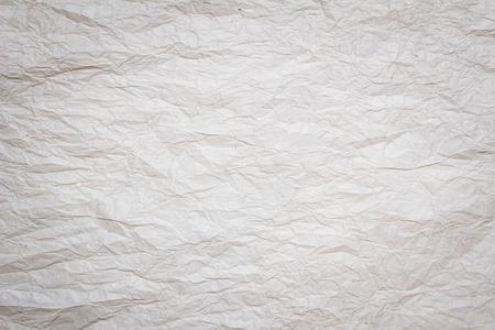 crinkles: wrinkled white paper background,
