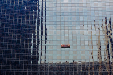 window cleaner: workers are leaning glass wall Stock Photo