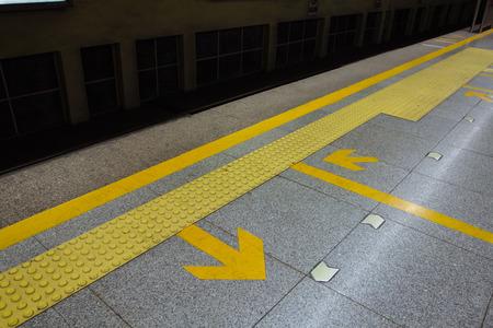 arrow on the road,subway station photo
