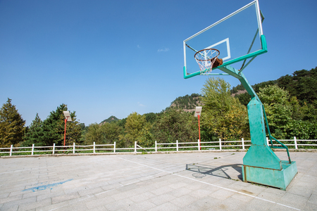 the stands: Basketball stands in an outdoor basketball court