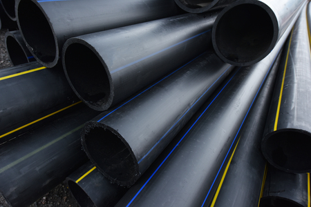 Large Black Plastic Pipes for Water Supply. Stockfoto