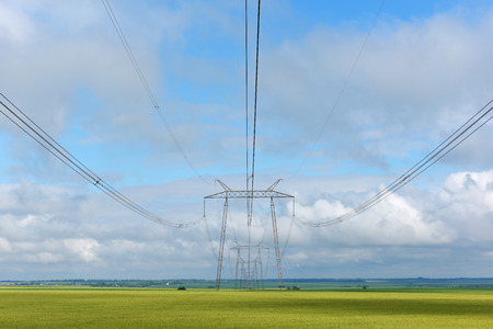 Very long wires and large power transmission poles.