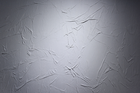 Texture of a wall with a jammed gray wallpaper.
