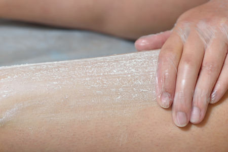 Preparation of skin for sugaring. The skin is treated with a powder. Stock Photo