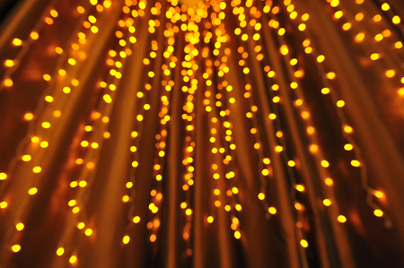 Beautiful bokeh from garlands, lens defocusing. Yellow and orange colors. 版權商用圖片