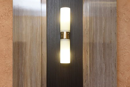 Beautiful vertical sconce on the wall in the hall. Stock Photo