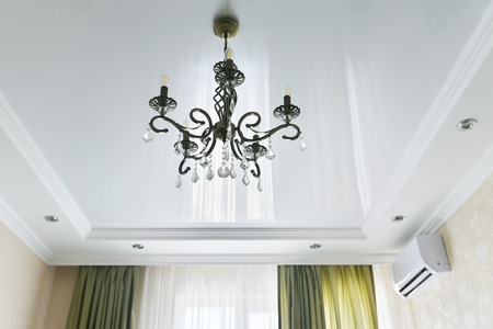 Beautiful iron chandelier of bronze color. The forged chandelier on the ceiling. Stok Fotoğraf