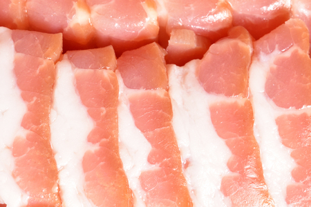 Beautiful sliced bacon. Sliced bacon smoothly laid close-up.