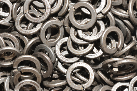 Texture set of metal washers for the assembly of products in the factory. Close Up Imagens