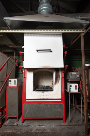 Industrial electric furnace for hardening metal parts. Hardening furnace with open door