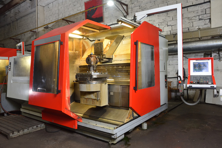 CNC machine for working with metal, slightly dirty, is in the factory.