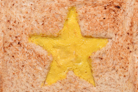 The texture of the surface of a fried sandwich with an omelette star.