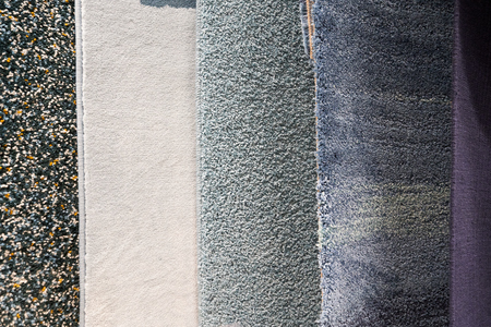 Different carpets of different colors for the bath or living room.