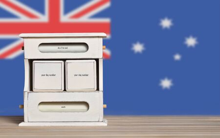 Wooden retro calendar with free space for a date on the background of the flag of Australia. Template for writing Australian national holiday dates with free text space.