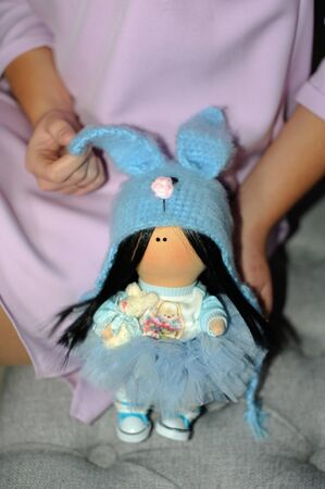 Girl holds hands soft baby cute doll, 写真素材
