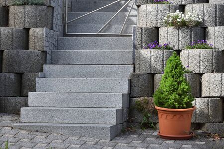 Garden staircase made of natural granite and a wall made of expanded clay concrete rings