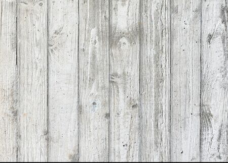 Texture of a light wooden wall with shabby and aged paint. Vintage surface