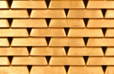 Gold bullion wall texture. Bright gold bullion Background, pattern