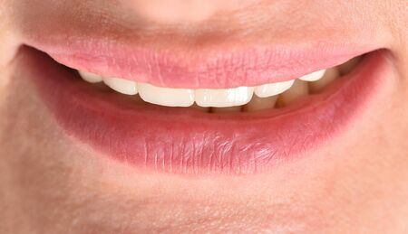 Female ceramic teeth and smile close-up. Beauty and body care concept