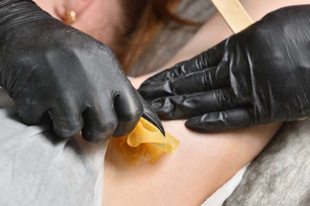 Waxing of female armpits. Close-up Beauty and body care concept.