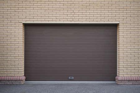 Brick wall and modern automatic garage door