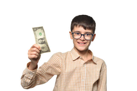 Happy teen boy showing his first dollar earned