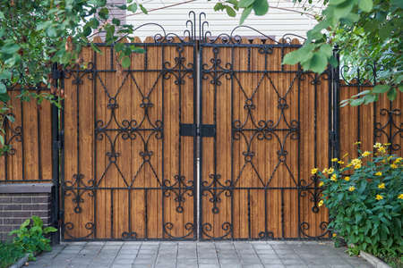 Brown metal gates with decorative elements